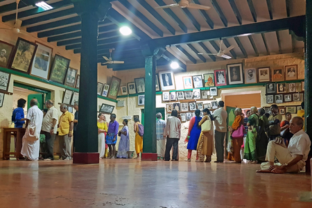 Tiruvanamalai, India - 8 december 2019: People going for dinner at the dining room in the Ramana Ashram in Tiruvanamalai India