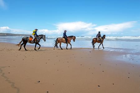 Horse riding at Carapateira beach in the Algarve Portugal Standard-Bild - 123552662