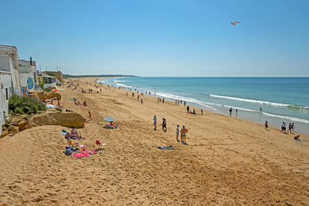 Armacao de Pera, Portugal - April 21, 2019: People enjoying at the beach in Armacao de Pera in the Algarve Portugal Standard-Bild - 123569402