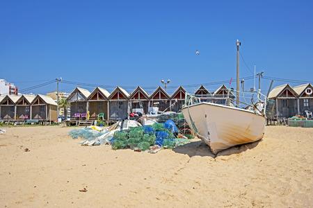 Traditonal fisherman huts on the beach in Armacao de Pera in the Algarve Portugal Standard-Bild - 123552690