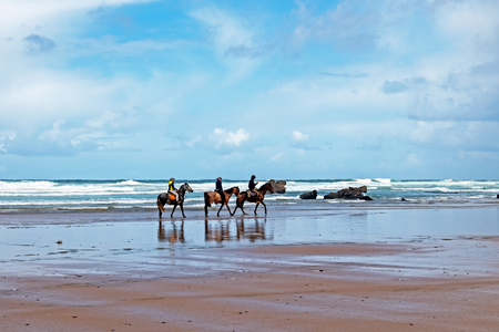 Horse riding at Carapateira beach in the Algarve Portugal Standard-Bild - 123552779