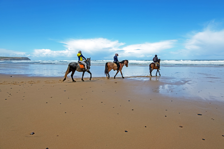 Horse riding at Carapateira beach in the Algarve Portugal Standard-Bild - 123552781