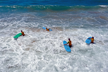 Vale Figueiras, Portugal - 25th may 2019: Aerial fromsurfers getting surfing lessons in the ocean Standard-Bild - 123571545