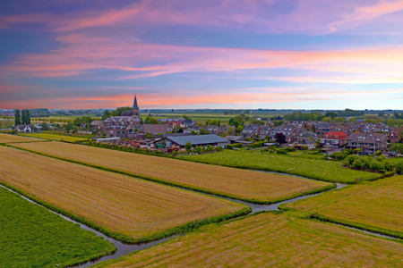 Aerial from a traditional dutch village in the countryside from the Netherlands Standard-Bild - 123552876