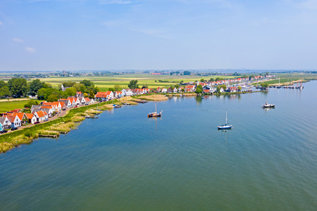 Aerial from the traditional village Durgerdam at the IJsselmeer in the Netherlands Standard-Bild - 123552878