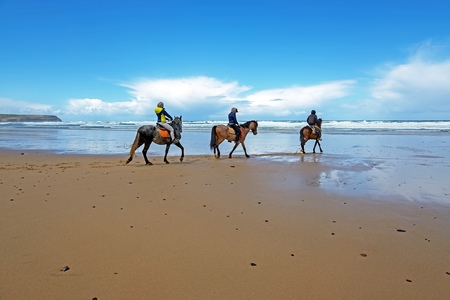Horse riding at Carapateira beach in the Algarve Portugal Standard-Bild - 123552885