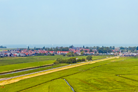 Aerial from the traditional village Marken at the IJsselmeer in the Netherlands Standard-Bild - 123552978