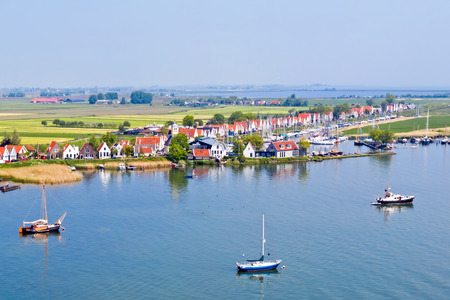 Aerial from the traditional village Durgerdam at the IJsselmeer in the Netherlands Standard-Bild - 123552979