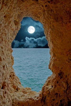 Natural rocks at Algar Seco in Carvoeiro Algarve Portugal at night at full moon Standard-Bild - 123552994