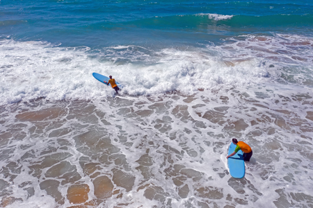 Vale Figueiras, Portugal - 25th may 2019: Aerial from surfers getting surfing lessons in the ocean Standard-Bild - 123571550