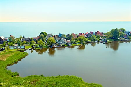 Aerial from the traditional village Uitdam at the IJsselmeer in the Netherlands