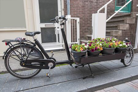 Bike cart full with flowers in the streets of Amsterdam the Netherlands
