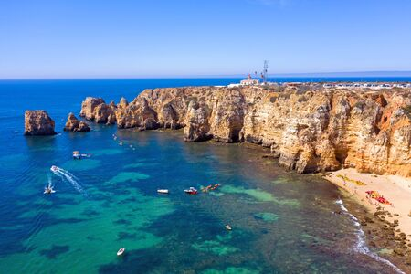 Aerial from natural rocks and the lighthouse at Ponte Piedade in Lagos Portugal