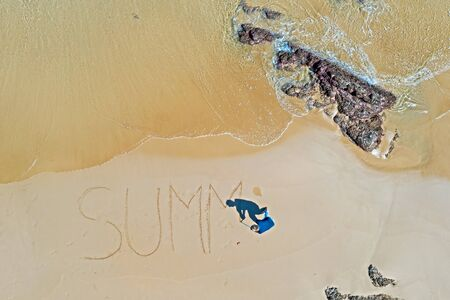 Aerial top shot from ocean waves and handwritten Summer at the beach Imagens