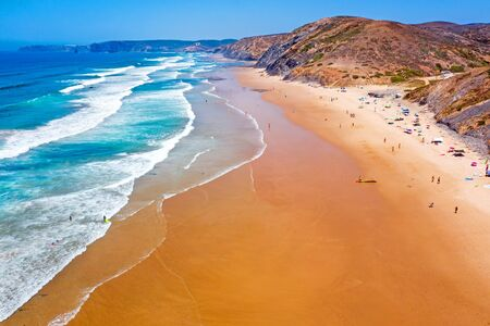 Aerial from Vale Figueiras beach on a beautiful summer day in Portugal