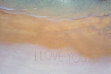 Aerial top shot from ocean waves and handwritten I love you at the beach Stok Fotoğraf