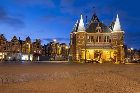 City scenic from Amsterdam with the Waag building in the Netherlands at night 版權商用圖片