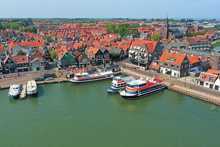 Aerial from the harbor and traditional village Volendam in the Netherlands Standard-Bild