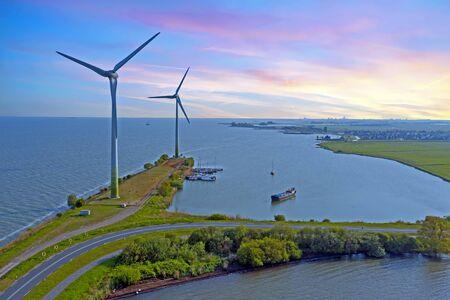 Windmills along the IJsselmeer in the Netherlands