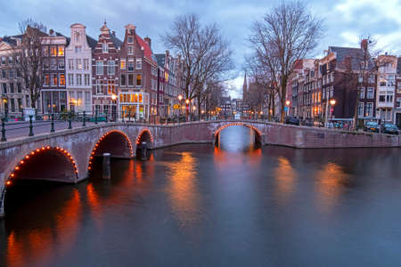 City scenic from Amsterdam at the Keizersgracht in the Netherlands at sunset