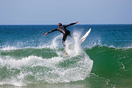 Surfer surfing the waves on the atlantic ocean