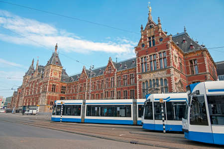 Trams waiting at Central Station in Amsterdam the Netherlands