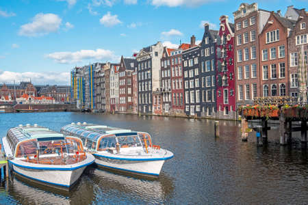 City scenic from Amsterdam at the Damrak in the Netherlands