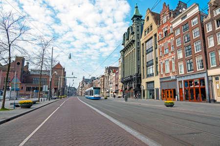 Tram driving at Damrak in Amsterdam the Netherlands