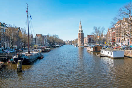 City scenic from Amsterdam in the Netherlands with the Montelbaan tower