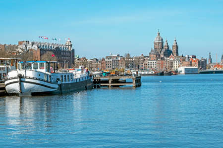 City scenic from the harbor of Amsterdam in the Netherlands with the St. Niklaas church