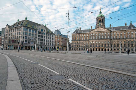 Damsquare in Amsterdam the Netherlands with the Royal Palace 新闻类图片