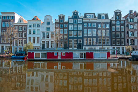 Traditional Amsterdam houses along the canal in the Netherlands