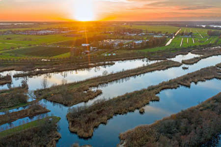 Aerial from the Ankeveense Plassen in the Netherlands at sunset