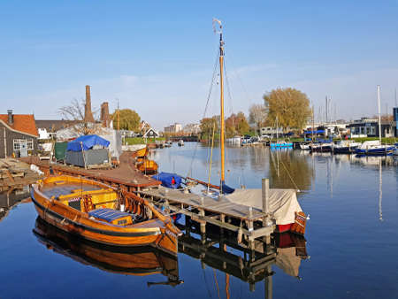 Harbor from Huizen with old fashioned sailing boats in the Netherlands