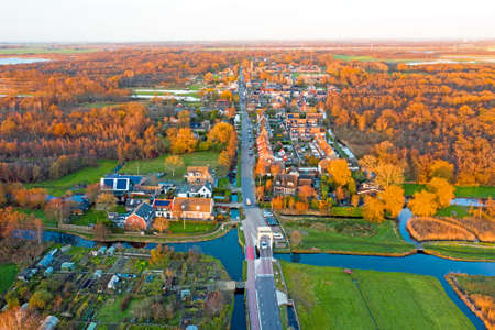 Aerial from the village Ankeveen in the contryside in the Netherlands in fall