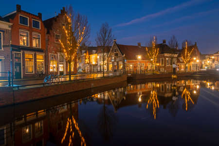 View on the city Sneek with christmas in the Netherlands at sunset