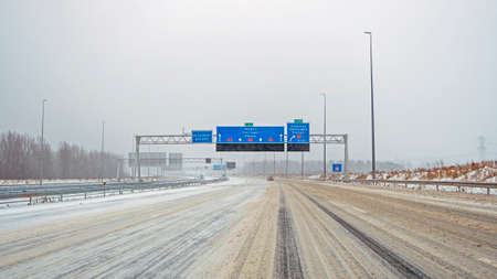 Driving on the highway A1 during a snowstorm in winter in the Netherlands