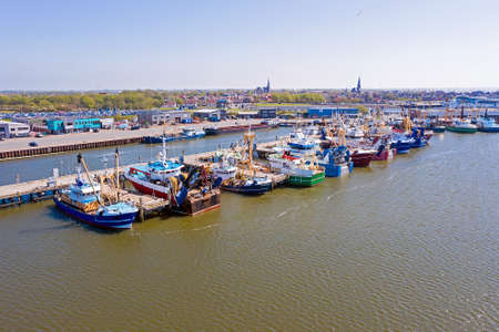 Aerial from the fishing harbor from Harlingen in the Netherlands 免版税图像