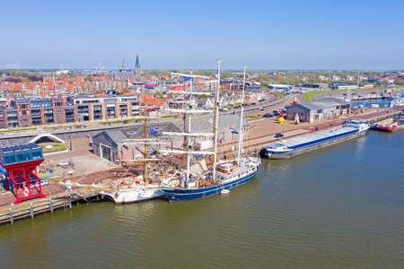 Aerial from the city Harlingen with traditional sailing ships in the Netherlands