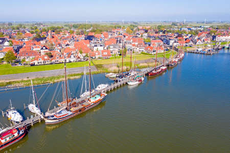 Aerial from the little village and harbor from Workum in Friesland in the Netherlands