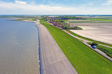 Aerial from the dyke near Wierum at the Wadden Sea in Friesland the Netherlands