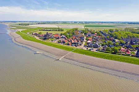 Aerial from the little village Wierum at the Wadden Sea in Friesland the Netherlands 免版税图像