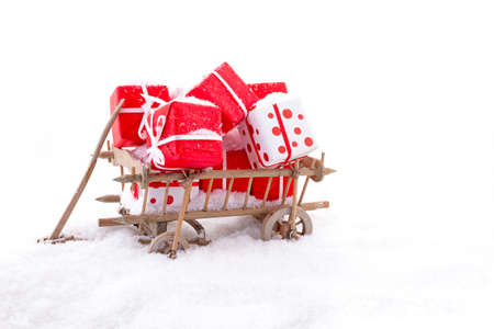 Wooden cart full of presents in the snow