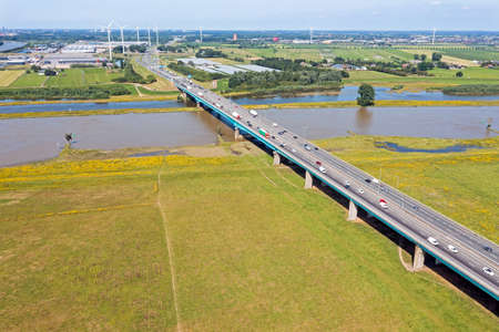 Aerial from the highway A27 near Nieuwegein at the Lek bridge in a flooded landscape in the Netherlands