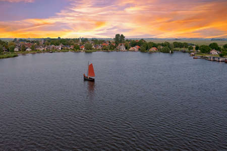 Aerial from the village Oudega in the Netherlands at sunset 免版税图像
