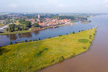Aerial from the city Woudrichem at the river Merwede in the Netherlands in a flooded landscape 免版税图像