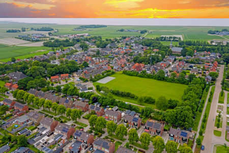 Aerial view on the medieval village Ternaard in Friesland the Netherlands at sunset 免版税图像