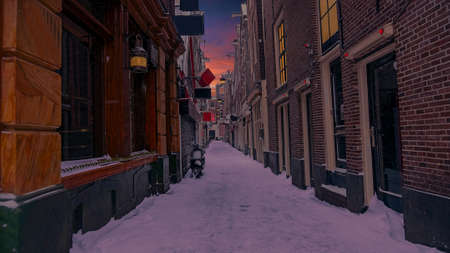 Snowy Red LIght District in winter in Amsterdam the Netherlands at sunset