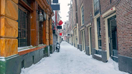 Snowy Red Light District in winter in Amsterdam the Netherlands