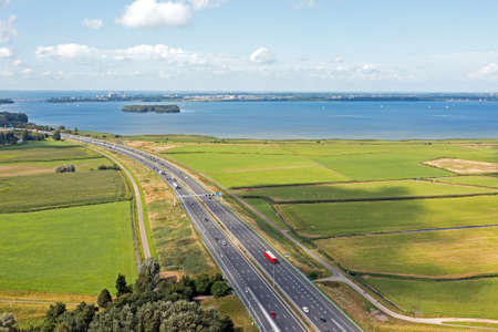 Aerial from the highway A1 near Amsterdam at the IJsselmeer in the Netherlands